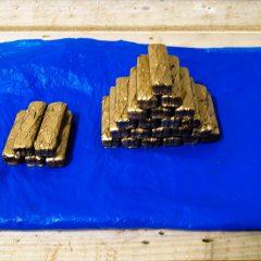Golden Mars Bar Offering* // Spray Paint, Є 100 worth of Mars Bars // 150 x 100 x 150 cm // 2010