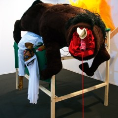 Race Riots @ Longchamp // Wood, Screws, Cardboard, Acrylic Paint, Glue, Fake Fur, Felt, Leatherette, Wool, Cotton, Nylon, Foam Stuffing, Papier Mache, Brass Eyelets, Rubber Hose, Sunglasses, Hair, Tie Wraps, Electrical Fans, Digital Print of Degas 'Fallen Jockey' // 200 x 200 x 120 cm // 2008