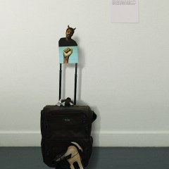 Residual Residency // Suitcase, Boots, Cardboard, Digital Prints, Text // 120 x 45 x 30 cm // 2005