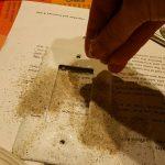 Sprinkle sand on glue