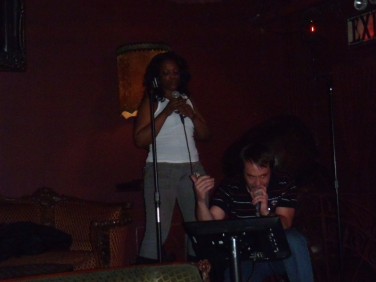 """Dan singing karaoke with Shalonda, """"Empire State of Mind"""", in New York City"""