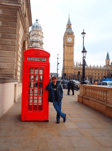 Never Ending Honeymoon | Jacqui Travels and Alex Moore in phone booth near Big Ben, London, UK