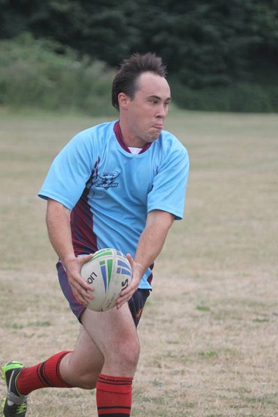 Dan playing rugby