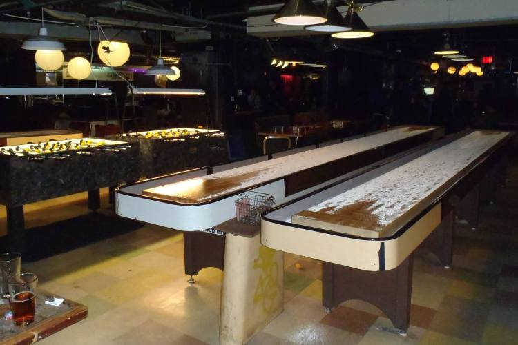 Beating Daniel at shuffle board in New York City