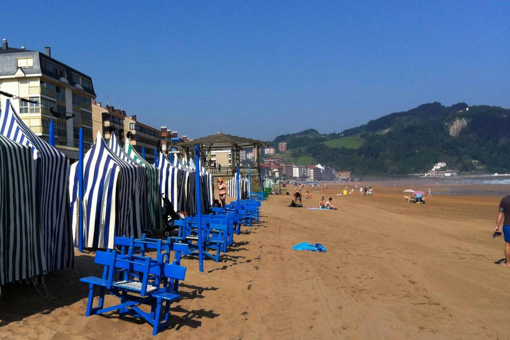 Blue and white tents on the beach in Zarautz, Spain