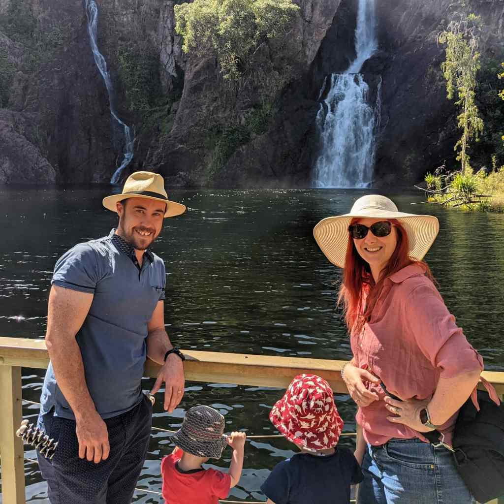 A family pose in front of Wangi Falls at Litchfield National Park