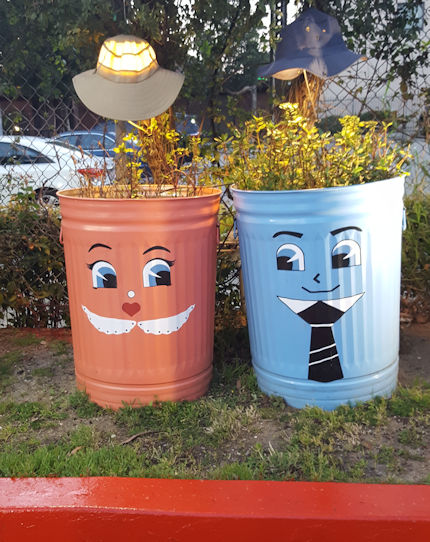 Whimsical his and her trash cans in Studio City
