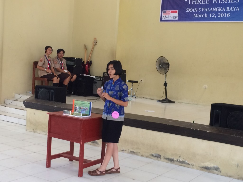 Theresia doing story telling as her talent