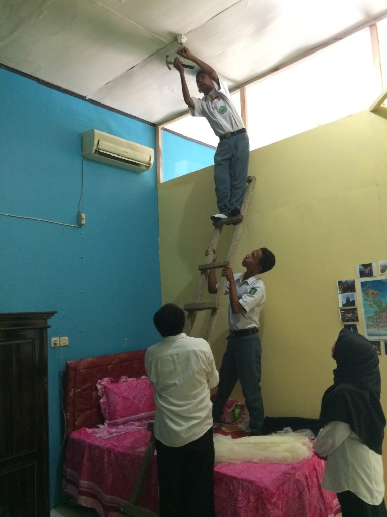 Bought a mosquito net in Bandung and my coteacher recruited some of my students to help put it up