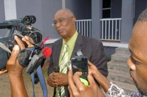 Former Premier, Hon. Joseph Parry with local media.