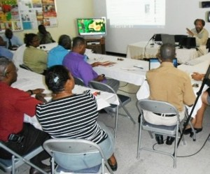 Director of the Nevis Disaster Management Department Lester Blackett gives updates at the Nevis Disaster Management Committee's first meeting for 2013 which was held on August 15, 2013 at the Llewellyn Newton Disaster Management Facility at Long Point