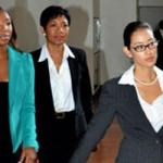 Olympic relay gold medalist, Sherone Simpson (left), accompanied by attorney-at-law, Danielle Chai (right), and support staff, Winsome Young