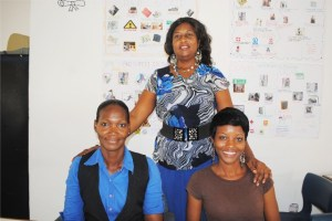 Senior students, Ms Arlene Rawlins (left) and Ms Keisha Henry (right) pose for a picture with Facilitator Averil Archibald.