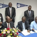Officials from the Government of St. Kitts and Nevis, the Ministry of Education, the Clarence Fitzroy Bryant College (CFBC) and the University of the Virgin Islands (UVI) sign the Memorandum of Understanding in July 2013.