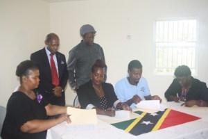 Signing of memorandum of understanding. L-R Telca Wallace, P.M. Denzil L. Douglas, P.S. Ashton Stanley, Dr. Joyelle Clarke, Meshach Alford, Natasha Leader