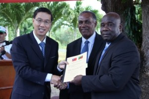 Signed documents handing the Republic of China/Taiwan's Demonstration Farm at Cades Bay to the Nevis Island Administration by (l-r) Republic of China/Taiwan's Resident Ambassador to the Federation His Excellency Miguel Li-Jey Tsao to Premier of Nevis Hon. Vance Amory and Minister of Agriculture on Nevis Hon. Alexis Jeffers on December 06, 2013