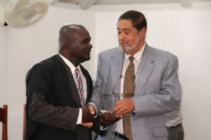 President of the Nevis Island Assembly, Honourable Farrell Smithen (left) receiving an awarded for his service and dedication to the Nevis House of Assembly from Deputy Governor General His. Honour Eustace John on December 10, 2013 at the Nevis Island Assembly Chambers, Hamilton House. Mr. Smithen first served the Assembly in the capacity of Clerk of the House