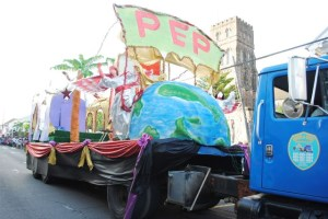 PEP is a Blessing: The 40-foot float on Cayon Street as it passes the Anglican Church.