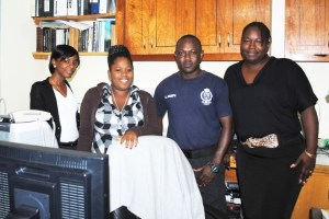 PEP workers at the Scenes of Crime Unit, from left, Ms Melissa Mason, Ms Shaunice Vaughan, Police Constable Nallie Joseph, and Ms Glennor Henry.