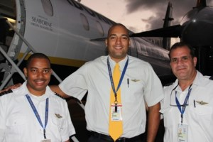 Captain and crew of the Seaborne Airlines after its inaugural flight into the Vance W. Amory International Airport on January 15, 2014. (L-R) First Officer Alex Alcantara, Flight Attendant Bruce Padilla and Captain Hugo Vissepo
