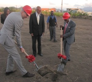 St. Kitts and Nevis' Prime Minister the Rt. Hon. Dr. Denzil L. Douglas (right) and Head of the European Delegation to Barbados and the Eastern Caribbean His Excellency Mikael Barford turn the sod as Governor General His Excellency Sir Edmund Lawrence looks o