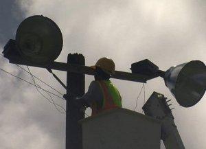Workmen installing the lights