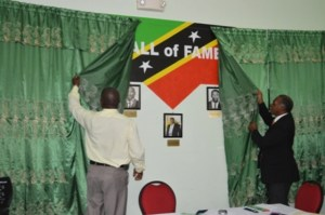 (L-R) Principal of the Charlestown Secondary School (CSS) and Sixth Form College Edson Elliott and Premier of Nevis and Minister of Education Hon. Vance Amory unveil the CSS Library & Media Centre's Hall of Fame on February 07, 2014