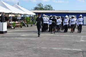 Graduating Class turns eyes right as they march pass the Governor General
