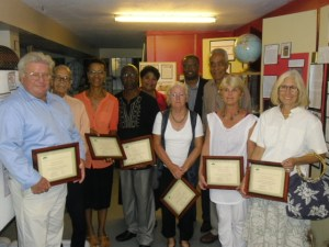 (L-R front) Awardees for long standing service to the Nevis Historical and Conservation Society Richard Lupinacci, Arthur Evelyn, Isabel Byron, Hanzel Manners, Jenny Lowery, Susan Gordon and Beverly Robinson. (Back row) Executive Director of the Nevis Historical and Conservation Society Evelyn Henville, Deputy Premier of Nevis and Minister of Culture Hon. Mark Brantley and Lloyd Hezekiah