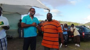 Arthur CABBAGE Farrell collects winnings from Hon Mark Brantley