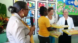 Elizabeth Pemberton Primary School Principal Marion Lescott (extreme left) with Grade 5 student Kalianne Smith presents gifts to certified Art teachers of the Glen Urquhart School in Massachusetts Catherine Cobb and Sandra Thoms at the opening ceremony of an art exhibition at the School on March 07, 2014