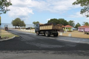 Locally owned trucks used to transport material for the resurfacing of the Samuel Hunkins Drive on April 04, 2014