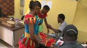 Students being fitted with costumes tailored by Banker's Mas Camp at the Culturama Secretariat on June 04, 2014