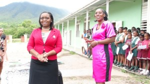 (L-R) Education Officer and Language Arts Coordinator in the Department of Education on Nevis Avril Elliott with Principal of the Ivor Walters Primary School Janice Richards and some of the students present at the handing over of books for the school library and school supplies from the University of Virginia and partners on May 27, 2014