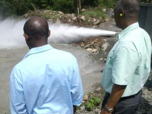 St. Kitts and Nevis' Prime Minister the Rt. Hon. Dr. Denzil L. Douglas (left) and then Premier of Nevis, the Hon. Joseph Parry looking at steam coming from a successful drill for geothermal in Nevis.