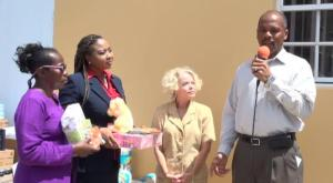 (L-R) Voices of Women (VOW) members Gweneth Browne and Nichole Lawrence with Linda Thomas who presented a gift of bedding, toys and books through VOW for the Paediatric Ward at the Alexandra Hospital and Hospital Administrator Gary Pemberton on August 07, 2014