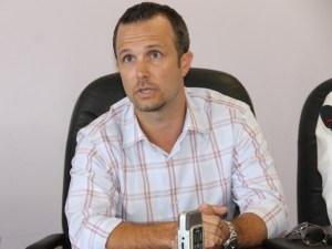 Chief Operations Officer of Omni Alpha Chris Burgess at the Nevis Island Administration conference room on September 24, 2014