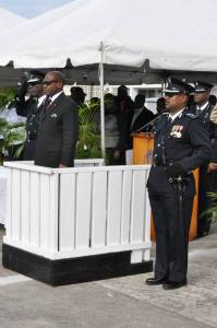 Prime Minister the Right Honourable Dr. Denzil Douglas flanked by Commissioner of Police Celvin G. Walwyn (left) and Assistant Commissioner of Police Ian Queeley
