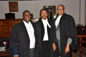 Mr. Anthony Johnson (left), Ms. Yvonne Bussue (center) and the Hon. Marcella Lburd