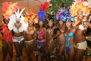 Models in Sugar Mas costumes welcome the pokers players to St. Kitts