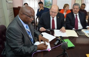 PM Harris signs sugar workers compensation upgrade agreement