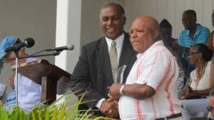 Premier of Nevis Hon Vance Amory presenting Frankie Claxton Evelyn with his award at the Gulf Insurance Inter-Primary Schools Championship Opening Ceremony Elquemedo T. Willett Park on April 01, 2015
