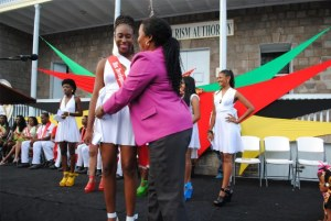 Mrs Jean Alcendor-Browne, the Development Bank's Credit Risk Management Officer in the Nevis Branch adorning Ms Jonieka Smithen with the bank's sash.