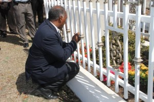 Premier of Nevis Hon. Vance Amory lays a wreath on the grave of the late Malcolm Guishard at Bath Cemetery on June 11, 2015, on the anniversary of his passing