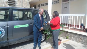 Mr. Paul Mason hands over keys to Hon Hazel Brandy- Williams