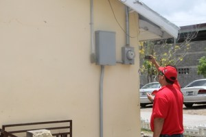 Members of the Venezuelan delegation assessing the electricity supply at the Charlestown Secondary School on June 04, 2015