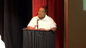 Co-ordinator of the School Librarian's Association Londa Browne giving remarks at the 6th annual joint School Libraries and Department of Education's Warner's One Stop Family Book Feud on July 11, 2015, at the Nevis Performing Arts Center