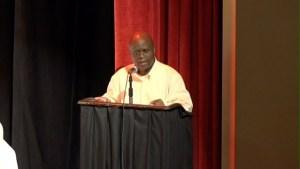 Permanent Secretary in the Premiers Ministry Wakely Daniel giving remarks at the 6th annual joint School Libraries and Department of Education's Warner's One Stop Family Book Feud on July 11, 2015, at the Nevis Performing Arts Center