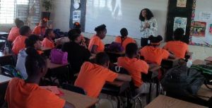 Danielle La Place, Executive Officer in the Department of Gender Affairs, presents to students at the Washington Archibald High School