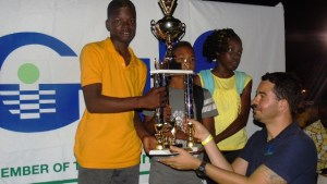 Students from the Elizabeth Pemberton Primary School accepting their winning trophy for Division B from a Gulf Insurance Representative during the presentation ceremony at the end of the 24th Gulf Insurance Athletics Championships at Elquemedo T. Willet Park on March 30, 2016